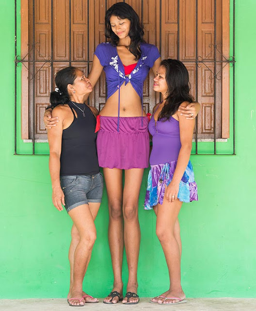 TALLEST OF THEM ALL ... ELISANY DA CRUZ SILVA WITH MUM, LEFT, AND SISTER