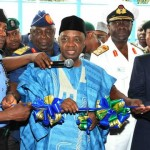 VICE PRESIDENT NAMADI SAMBO (M), CUTTING THE TAPE TO COMMISSION FORCE CID BUILDING COMPLEX IN ABUJA ON TUESDAY