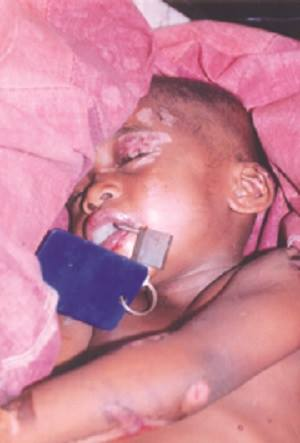 Father padlocks son's mouth to prevent him from shouting while beating him to death (photo) - INFORMATION NIGERIA