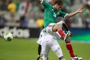 Nigeria's Ogenyi Onazi Battles for the Ball With Manchester United and Mexico Striker Javier Hernandez.