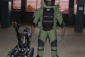 A-KITTED-POLICE-OFFICER-STANDING-BESIDE-ONE-OF-THE-BOMB-DISPOSAL-ROBOTS-PRESENTED-TO-THE-NIGERIA-POLICE-FORCE-BY-THE-US-EMBASSY