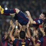 Lionel Messi is Been Thrown Into the Air By His Team-Mates in Front of Over 78,500 Camp Nou Fans After Breaking the La Liga Goal Record. Image: Getty.