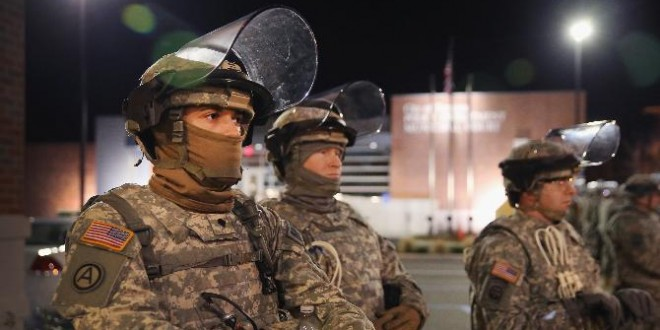 National Guard, Police Curb Ferguson Unrest As Protests Swell Across U.S.