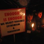 Students hold candles for the victims of the Pakistan Taliban attack on the Army Public School, during a rally in Lahore