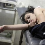 Injured boy lies at a field hospital after what activists said were air strikes by forces of Syria's President Assad in the Duma neighbourhood of Damascus