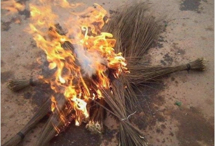Photos: Youths burn APC flag and brooms in Imo state