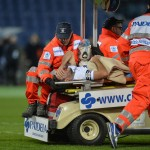 Serb Filip Djordjevic Wheeled Off the Pitch After Fracturing His Ankle Against AC Milan. Image: Getty.