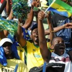 Gabon Fans Wave Flags and Pom Pom During a Football Game Against Morocco. Image: Getty.