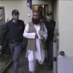 Still image from video shows Italian Policemen detaining a man suspected to be member of armed organisation inspired by al Qaeda in this still image taken from a video released by Italian Police