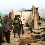Fayose inspects the burnt market  source: Vanguard