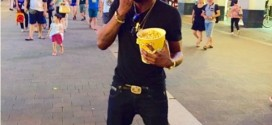 See What Singer Kcee Was Caught Eating On The Street Of China