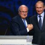 FIFA's President Sepp Blatter shakes hands with Russia's President Vladimir Putin (R) during the preliminary draw for the 2018 FIFA World Cup at Konstantin Palace in St. Petersburg, Russia July 25, 2015. REUTERS/Stringer - RTX1LRWQ