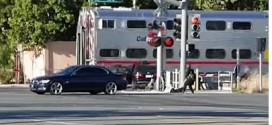 California police drag man out of the way of an oncoming train