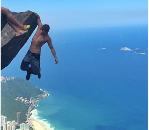Man Is Hanging Off A Cliff But It's What His GF Is Doing