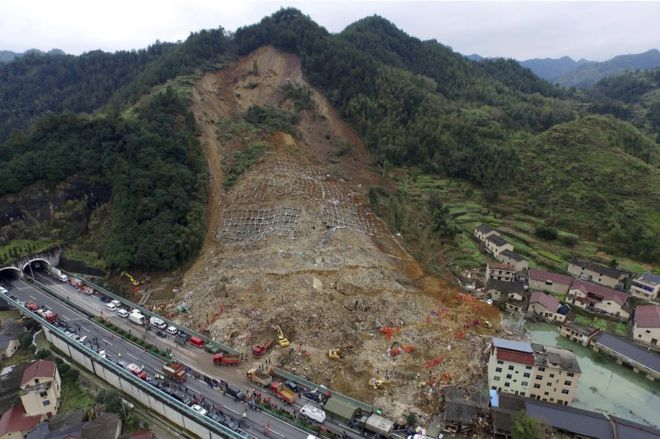 China Landslide Search For Survivors Continues As Death