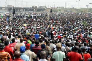 Leadership of labour and civil society speaks to thousands of people protesting against the scrapping of oil subsidy at Gani Fawehinmi Park in Lagos, on January 11, 2012.  Thousands of protesters gathered at the Gani Fawehinmi Park in the third day of on-going mass strike by labour and civil society to protest the scrapping of oil subsidy by the government. AFP PHOTO/PIUS UTOMI EKPEI (Photo credit should read PIUS UTOMI EKPEI/AFP/Getty Images)