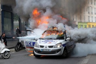 Protesters torched a police car on Wednesday