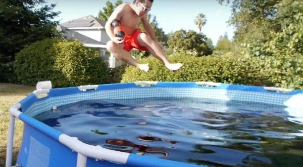 Man-bathes-in-1500-gallon-swimming-pool-filled-with-Coca-Cola-Mentos-and-ice