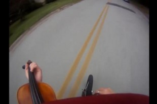 Man-rides-bike-while-playing-violin-in-Tennessee