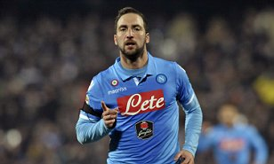 Napoli's Gonzalo Higuain celebrates after scoring during the Serie A soccer match against Cesena, at Cesena's Manuzzi stadium, Italy, Tuesday, Jan 6, 2015.(AP Photo/Marco Vasini)