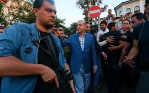 103443976_Turkish_President_Tayyip_Erdogan_walks_through_the_crowd_of_supporters_protected_by_bodygu-large_trans++Ujqj5Zs64CwNV5G7BJzo7CqzdYHm7dATQVQVrYmPSwA