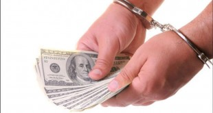 09252012_money_handcuffs_article