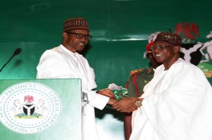"""PRESIDENT BUHARI LAUNCH 'CHANGE BEGINS WITH ME' 1A&. L-R; President Buhari presenting the handover of the """"CHANGE"""" to the Minister of Information and Culture, Alhaji Lai Mohammed during the launch of the National Re-Orientation Campaign """"Change Begins with Me"""" at the State House Conference Centre (SHCC) in Abuja. PHOTO; SUNDAY AGHAEZE.. SEPT 8 2016"""