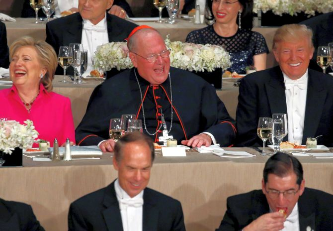Clinton, Dolan and Trump sit together at the Alfred E. Smith Memorial Foundation dinner in New York