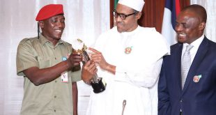 PRESIDENT BUHARI RECEIVES GLO CAF AWARD 3. President Muhammadu Buhari (M) falnked by the Minister of Youth and Sports, Barrister Solomon Dalung ( left) and Permanent Secretary, Mr Chinyeaka Ohaa ( right) as President Buhari receives GLO CAF Platinum Award for Good Leadership at the State House in Abuja. PHOTO; SUNDAY AGHAEZE. JAN 11 2016.