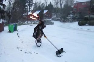 portland-man-shovels-snow-while-riding-unicycle-playing-bagpipes