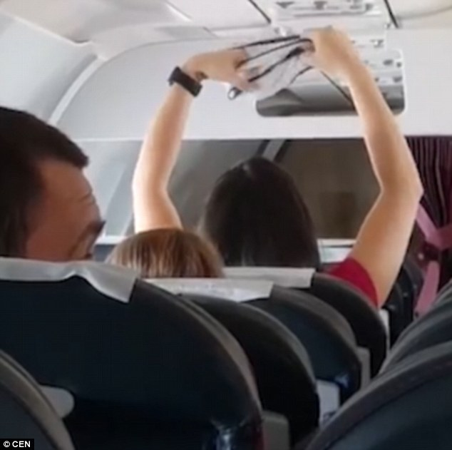 Female Passenger Shocks Everyone After Bringing Out Her Wet Panties To Dry Inside Plane (Photos)