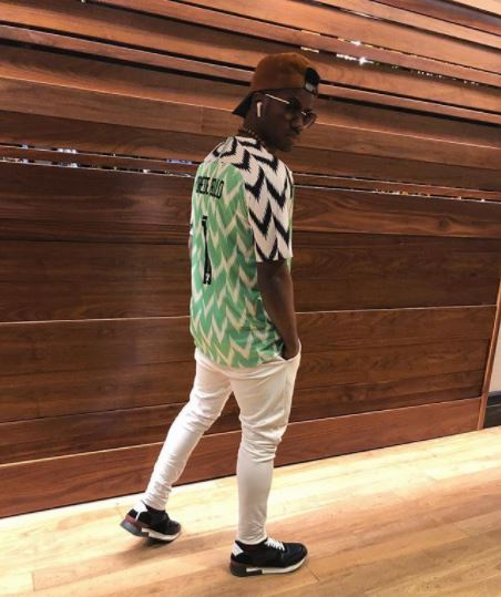 25f335550 Korede Bello Spotted Rocking His Own Customized New Super Eagles Jersey In  New Photo