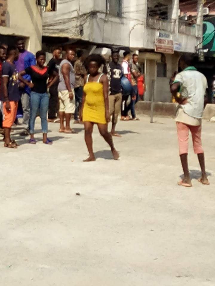 Nigerian Lady Runs Mad After Standing For Hours At Betting Shop In
