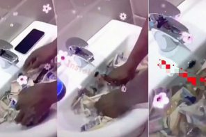 Nigerian man spotted seriously washing his money and phone (VIDEO)
