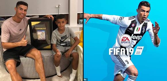 Cristiano Ronaldo proudly covers the world's first copy of FIFA'19