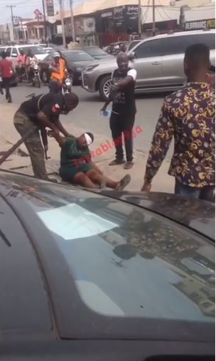 Drama As Woman Suddenly Collapses In Front Of Zenith Bank In Lagos (Video)