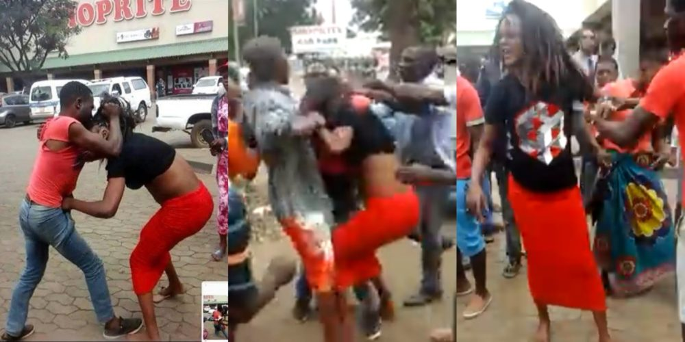 Man & woman pictured fighting outside a Shoprite Mall