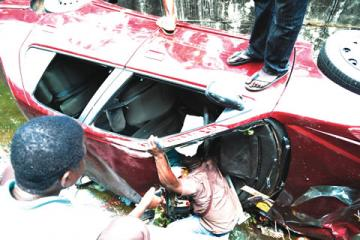 PHOTO: Three Killed As Car Drives Into Pedestrians In Lagos, Driver Almost Lynched