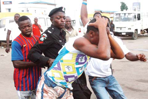 The Suspected Thief As He Is Being Dragged To The Police Station