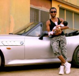 ASURF OLUSEYI PICTURED WITH THE CAR AND HIS NEWBORN BABY