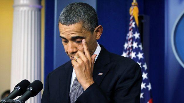 121412-national-obama-shooting-press