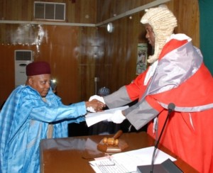 GOVERNOR KASHIM SHETTIMA PRESENTING THE BUDGET PROPOSAL TO THE SPEAKER OF THE STATE HOUSE OF ASSEMBLY, ABDULKARIM LAWAN.