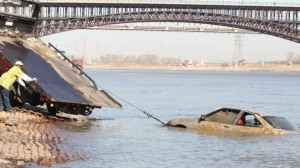 Car-plunges-into-river-after-wash