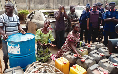 The-suspects-with-officials-of-NSCDC-480x300