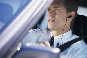 Businessman Driving and Talking on Phone