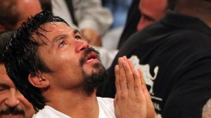 Pacquiao praying: I reject Parkinson's...