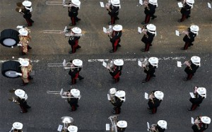 The Band of the Royal Marines plays as it follows the gun carriage along Fleet St.
