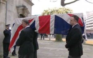 Thatcher's coffin is carried into St Clement Danes on the first part of its journey to St Paul's.