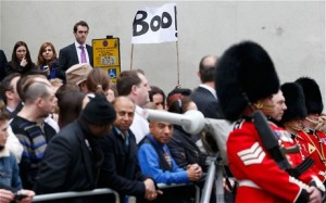 A protestor holds aloft his note of disapproval (GETTY)