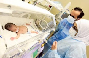 Ranim Amir and Hassan check on one of their babies at the Saudi-German Hospital in Dubai. Image Credit: Gulf News